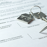 house keys on mortgage documents